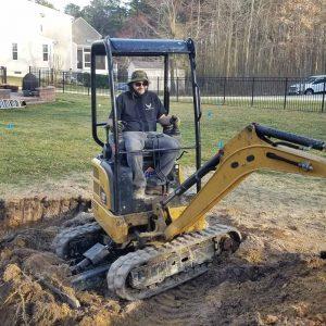 Atlantic Ponds Staff Excavating Pond Site