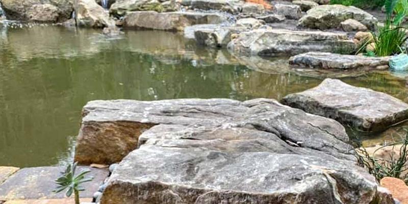 Natural-Rock-Diving-Platform-in-Recreational-Swimming-Pond