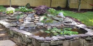 Rock-Wall-Pond-with-Small-Waterfall